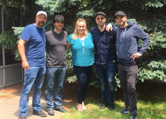 The 'Ghost Nation' team filmed at the Cerritos' Mantua Township home over five days in June. From left: Jason Hawes, Mario Cerrito III, Charmaine Cerrito, Dave Tango and Steve Gonsalves.