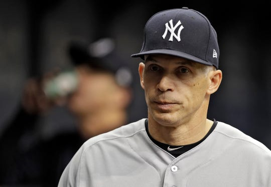 This May 20, 2017 file photo shows New York Yankees manager Joe Girardi during a baseball game against the Tampa Bay Rays in St. Petersburg, Fla.  Person familiar with deal tells AP the Philadelphia Phillies are hiring Girardi as manager.