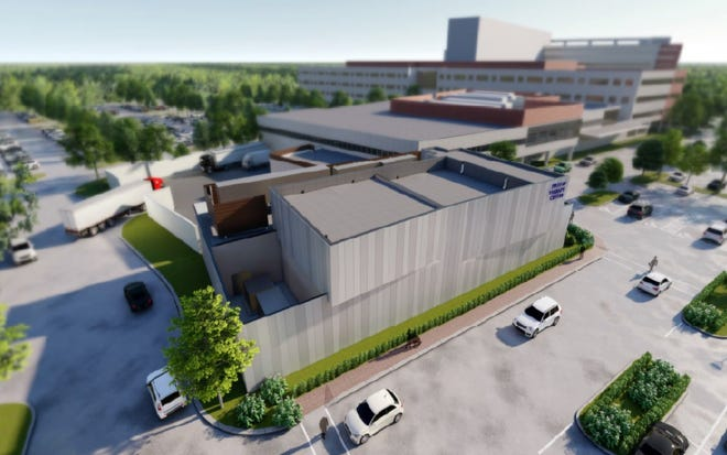 Virtua Health is seeking local approvals for a two-story proton therapy center attached to the Virtua Health and Wellness Center in Voorhees, as seen in an artist's rendering.