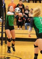 Huntington's Alyssa Steele digs a ball during a 3-0 win over Ironton in a D-III District Semifinal on Wednesday at Waverly High School.