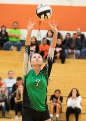 Huntington's Alyssa Steele sets a ball during a 3-0 win over Ironton in a D-III District Semifinal on Wednesday at Waverly High School.