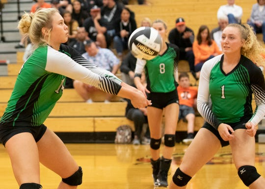 Huntington's Allison Basye digs a ball during a 3-0 win over Ironton in a D-III district semifinal on Wednesday, Oct. 23, 2019 at Waverly High School in Waverly, Ohio.