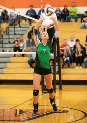 Huntington's Alyssa Steele sets a ball during a 3-0 win in the Division III District Semifinals on Wednesday at Waverly High School.