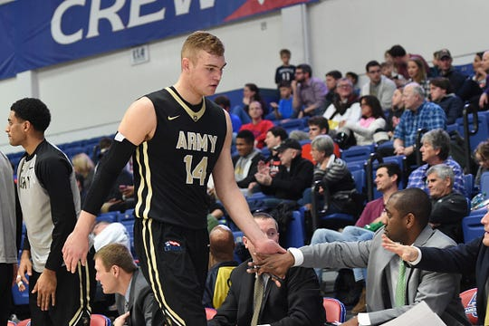 Matthew Wilson #14 of the Army Black Knights comes out of the game during a college basketball game against the American University Eagles at Bender Arena on January 14, 2017 in Washington, DC.