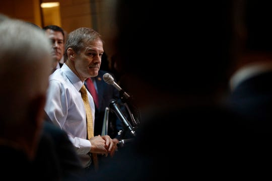 Rep. Jim Jordan, R-Ohio, with Rep. Mark Green behind him, speaks at a news conference in front of House Republicans after Deputy Assistant Secretary of Defense Laura Cooper arrived for a closed door meeting to testify as part of the House impeachment inquiry into President Donald Trump, Wednesday, Oct. 23, 2019, on Capitol Hill in Washington.