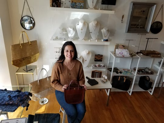 Christina Gianni, owner of Bling by Design, sits just inside the front entrance of the Bernardsville store.  After working in retail management for more than 20 years, she was a flight attendant for four years before moving into store ownership.