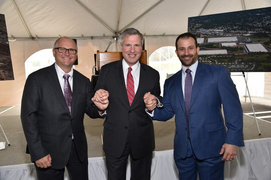 Piscataway Mayor Brian C. Wahler (center) joined Rockefeller Group's Mark Shearer (left), SVP and regional development officer for the New Jersey/Pennsylvania region and Heath Abramsohn (right), VP and regional director for the New Jersey/Pennsylvania region, to celebrate the opening of Rockefeller Group Logistics Center in Piscataway.
