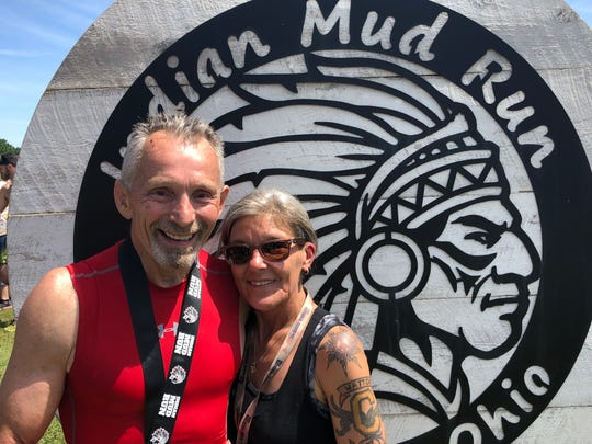 Amy Taylor and, Hubie Cushman, founder and race director of the Indian Mud Run.