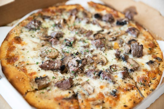 Mama Mia's Pizza and Sandwiches' Thin-Crust Steak de Burgo: A white pizza crust brushed with de Burgo oil, topped with mozzarella cheese, mushrooms, roasted garlic cloves, and tender steak tips. $15.95 pizza, $24.29 including delivery. Roughly 35-minute delivery.