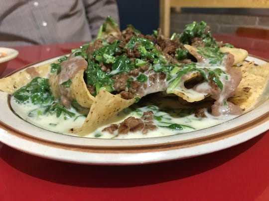 The Nachos Don Juan at El Aguila Real include beans, steak, spinach and cheese sauce.