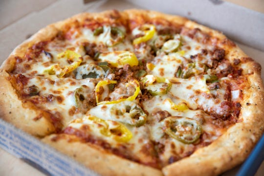 "Northern Lights' ""Fair's Best"": Spicy Italian sausage, onions, green peppers, jalapeños, banana peppers, garlic butter crust. $11 for a small pizza, $12 minimum for delivery. Roughly 50-minute delivery."