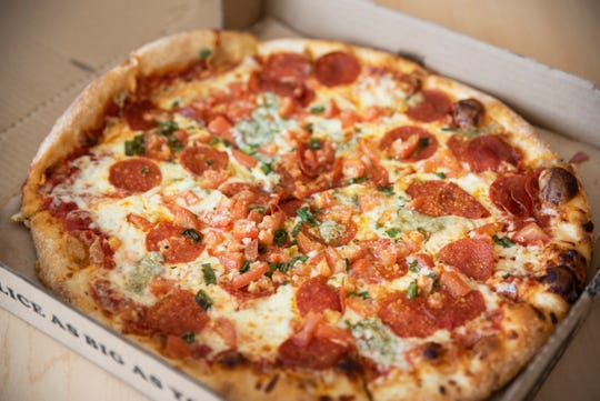 "Papa Keno's Pizzeria's ""Shredder"": Pepperoni, green onions, blue cheese, Roma tomatoes, Romano cheese. $21.23 including delivery. Roughly 45-minute delivery."