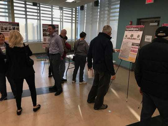 Indianola residents look at the city's comprehensive plan, which was on display at the YMCA Tuesday.