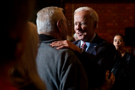 Former Vice President Joe Biden greets people in the crowd after giving remarks during a campaign event on Wednesday, Oct. 23, 2019, in Muscatine.