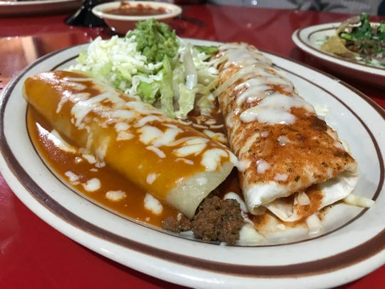 The number 19 combination dinner at El Aguila Real includes one chalupa, one beef burrito and one enchilada.
