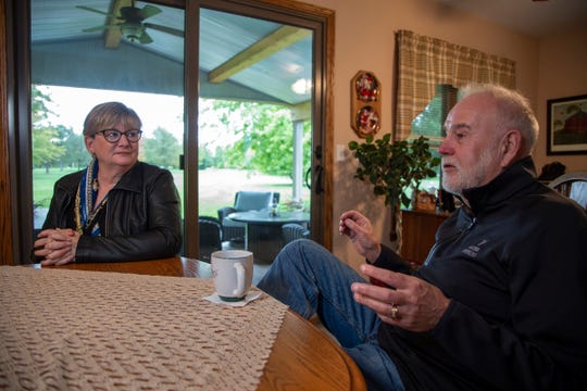 Margaret Rhead, left, and her husband Kim speak about her cancer journey from the kitchen of their Sandusky home Wednesday, Oct. 16, 2019. Rhead had 10 routine mammograms, but they came back inconclusive, and she wasn't willing to accept that result as meaning she was cancer free.