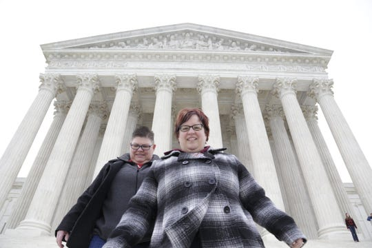 Jayne Rowse, left, and April DeBoer walk down the steps of the U.S. Supreme Court in Washington D.C. Saturday April 25, 2015.