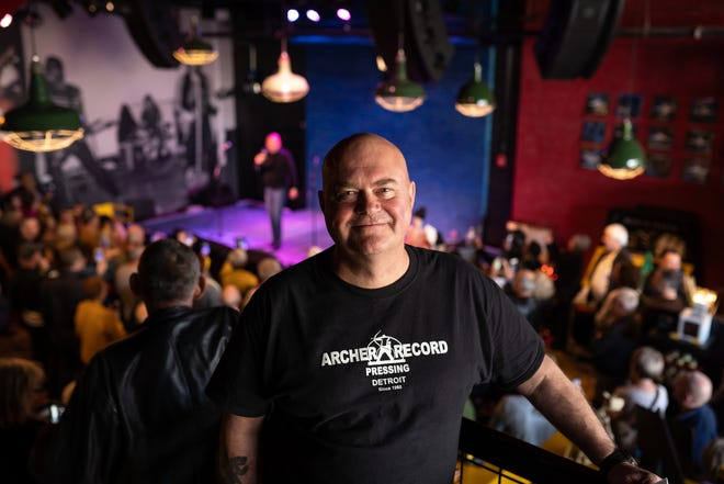 Motown A Go Go organizer Phil Dick poses for a photo as attendees listen to Spyder Turner sing during an event at Third Man Records in Detroit on Thursday, October 24, 2019. The annual event brings fans of obscure Detroit soul and Motown groups for a several-day celebration of that music.