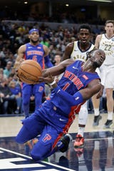Detroit Pistons' Reggie Jackson saves the ball from going out of bounds during the first half against the Indiana Pacers, Wednesday, Oct. 23, 2019, in Indianapolis.