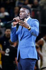 Victor Oladipo speaks to the Pacers crowd before the opener Wednesday.