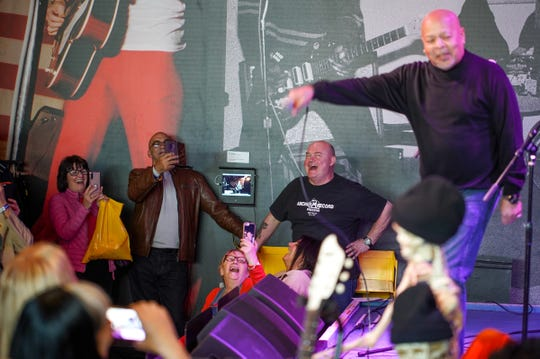 Motown A Go Go organizer Phil Dick (center) laughs with attendees as Spyder Turner performs during an event at Third Man Records in Detroit on Thursday, October 24, 2019. The annual event brings fans of obscure Detroit soul and Motown groups for a several-day celebration of that music.