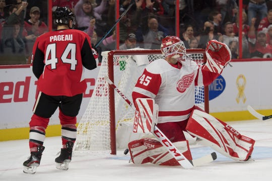 Senators' Jean-Gabriel Pageau scores against Red Wings goalie Jonathan Bernier in the second period Wednesday.
