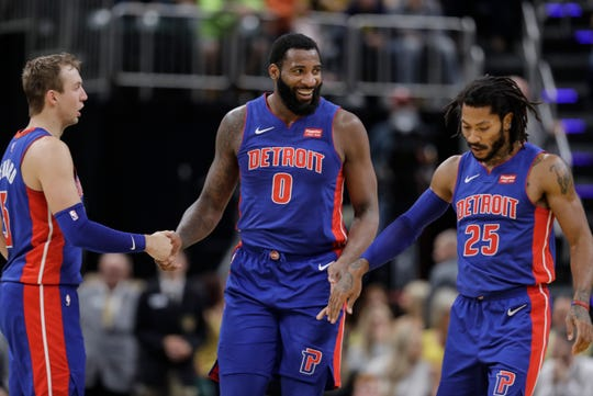 Detroit Pistons' Andre Drummond reacts with Luke Kennard, left, and Derrick Rose, right, during the second half against the Indiana Pacers, Wednesday, Oct. 23, 2019, in Indianapolis. Detroit won 119-110.