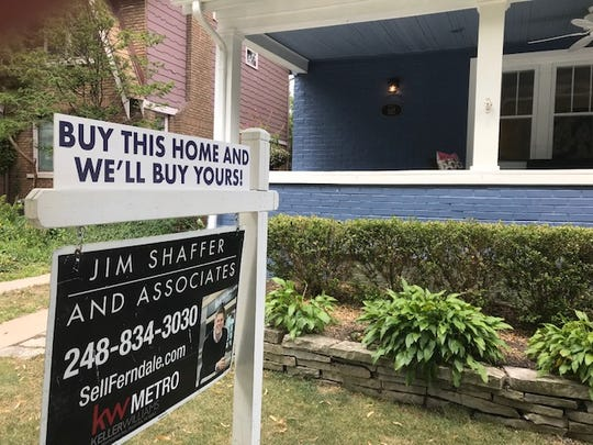 A home has a For Sale sign in the front yard that offers to buy your house, too, in Pleasant Ridge on Aug. 11, 2019.