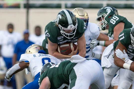 Rocky Lombardi (12) is likely the favorite to be Michigan State's starting quarterback next season, but he'll have to hold off the likes of Theo Day and Payton Thorne.