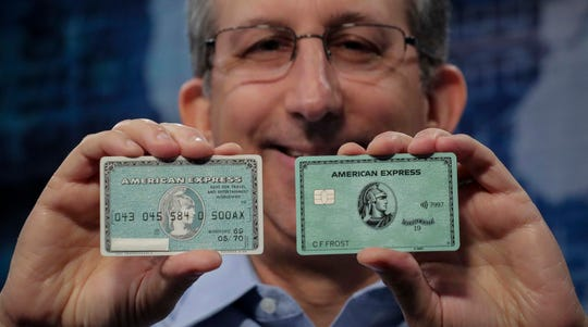 "Ira Galtman, American Express director of corporate archives, shows the original American Express ""Green Card,"" left, with its latest version in New York."