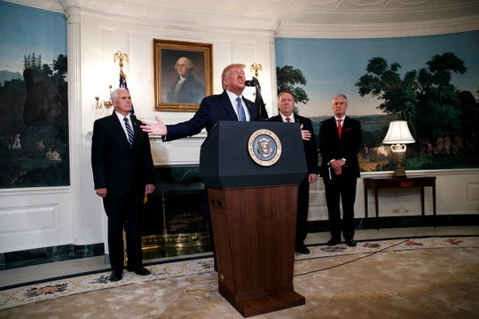 President Donald Trump speaks, Wednesday, Oct. 23, 2019, in the Diplomatic Room of the White House in Washington. The president was joined by Vice President Mike Pence, left, Secretary of State Mike Pompeo, and White House national security adviser Robert O'Brien.