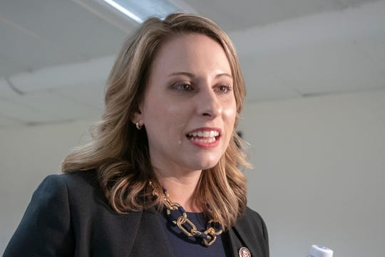 FILE - In this April 3, 2019, file photo, Rep. Katie Hill, D-Calif., talks on Capitol Hill in Washington. Hill says she's asked for an investigation into intimate photos she says were posted online without her consent.
