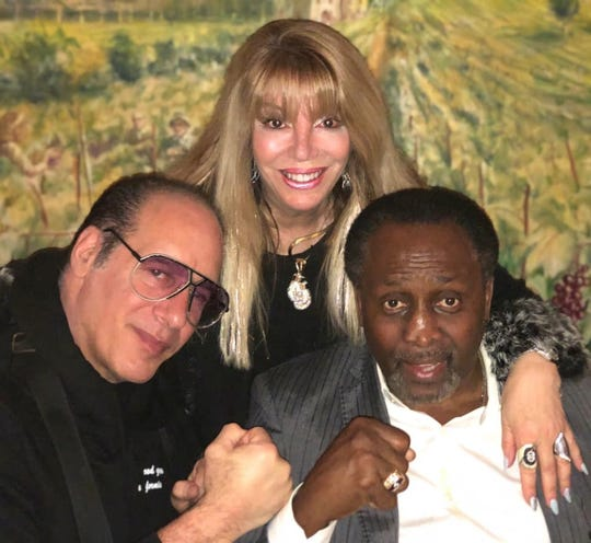 "From left, comedian Andrew ""Dice"" Clay, Jackie Kallen, and Tommy Hearns, celebrating Hearns' birthday at Andiamo Showroom."