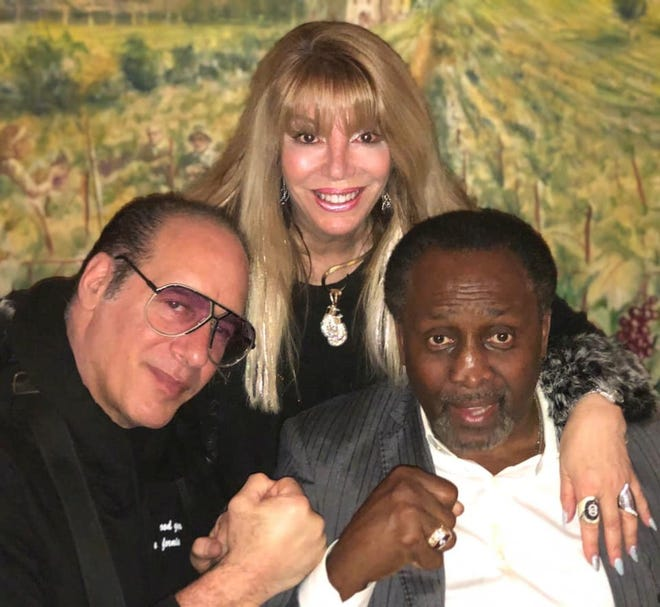 """From left, comedian Andrew """"Dice"""" Clay, Jackie Kallen, and Tommy Hearns, celebrating Hearns' birthday at Andiamo Showroom."""