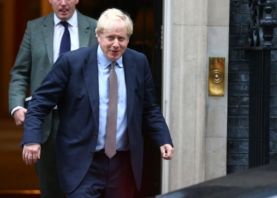 Britain's Prime Minister Boris Johnson leaves 10 Downing Street, on his way to parliament in London, Thursday Oct. 24, 2019.  In a TV interview Thursday Johnson has announced that he will offer lawmakers more time to scrutinize his Brexit legislation, but only if parliament agree for a General Election on December 12.