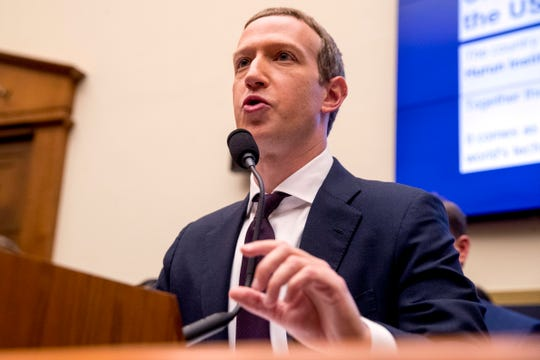 Facebook CEO Mark Zuckerberg testifies before a House Financial Services Committee hearing on Capitol Hill in Washington.