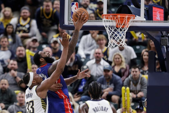 Pistons center Andre Drummond (0) goes to the basket against the Pacers' Myles Turner (33) during the second half Wednesday in Indianapolis.
