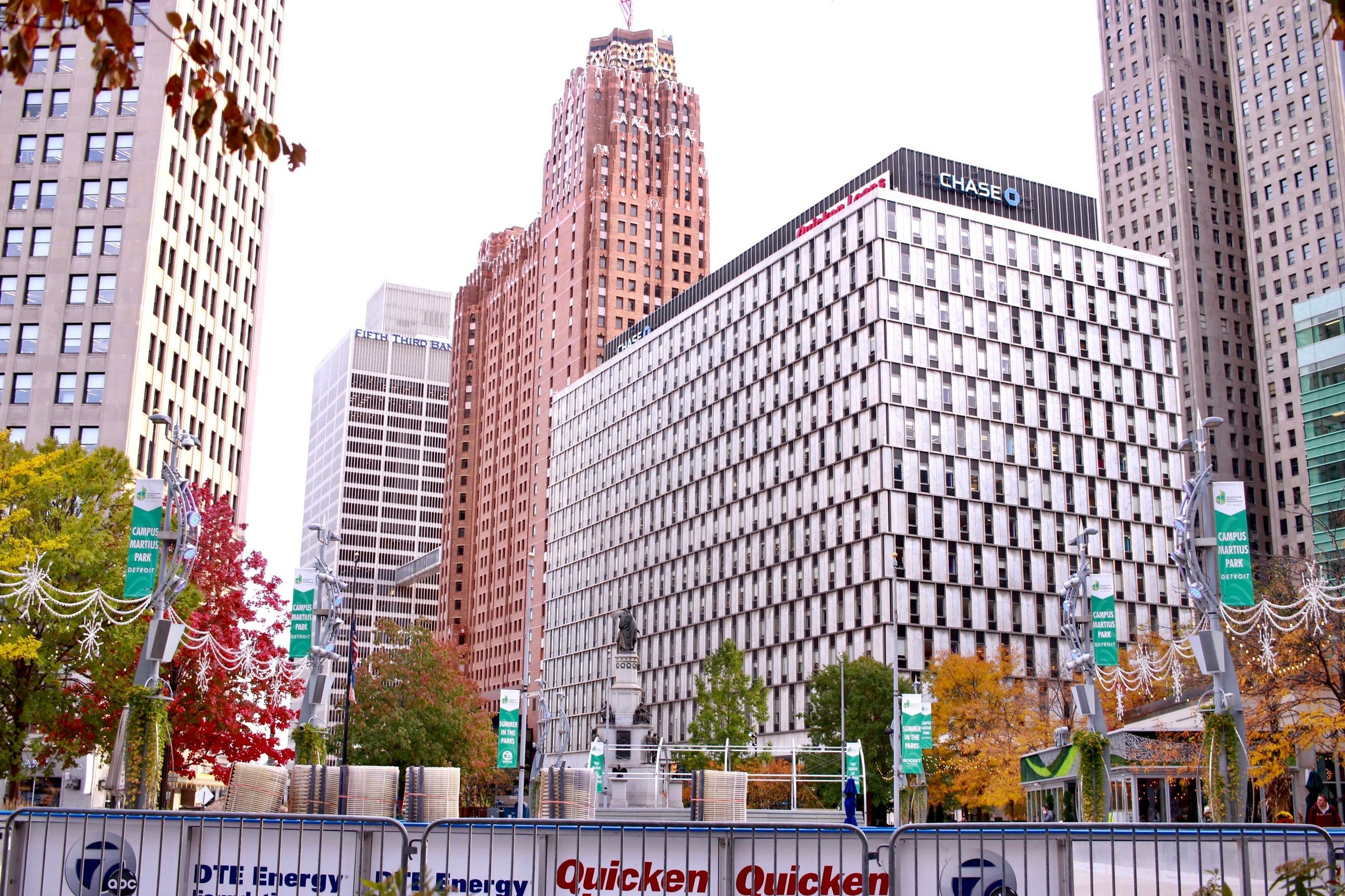 Campus Martius Park in downtown Detroit, looking south toward Chase Tower. The Gilbert property now sits in an opportunity zone, even though the census tract should have been ineligible for the program because of its wealth.