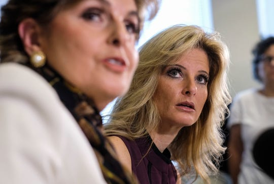 """Summer Zervos, right, listens alongside her attorney Gloria Allred during a news conference in Los Angeles, in this Friday Oct. 14, 2016, file photo. Zervos, a former contestant on """"The Apprentice"""" says Republican presidential candidate Donald Trump made unwanted sexual contact with her at a Beverly Hills hotel in 2007."""