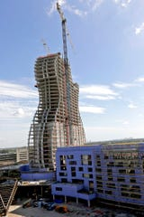 In this July 9, 2018 file photo, the new guitar tower is constructed as part of the guitar-shaped Seminole Hard Rock Hotel and Casino in Hollywood, Fla.