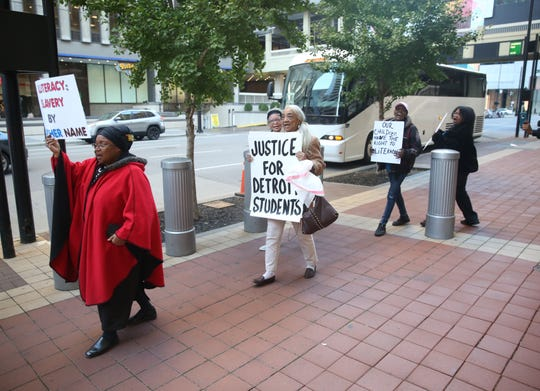 Helen White leads a group of protestors at the outside the federal courthouse in Cincinnati.