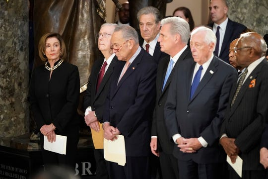 House Speaker Nancy Pelosi of Calif., Senate Majority Leader Mitch McConnell, Senate Minority Leader Chuck Schumer, House Minority Leader Kevin McCarthy, House Majority Leader Steny Hoyer, Rep. John Lewis and House Majority Whip James Clyburn, attend memorial services for the late Rep. Elijah Cummings, D-Md., at the Capitol in Washington, Thursday.