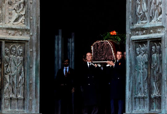 Relatives carry the coffin with the remains of Spanish dictator General Francisco Franco at the Valley of the Fallen mausoleum.