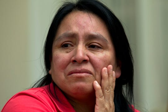 FILE - In a Wednesday, July 17, 2019 file photo, Maria Chavalan-Sut of Guatemala, one of a number of immigrants taking sanctuary at houses of worship, speaks during an interview at the Wesley Memorial United Methodist Church in Charlottesville, Va.