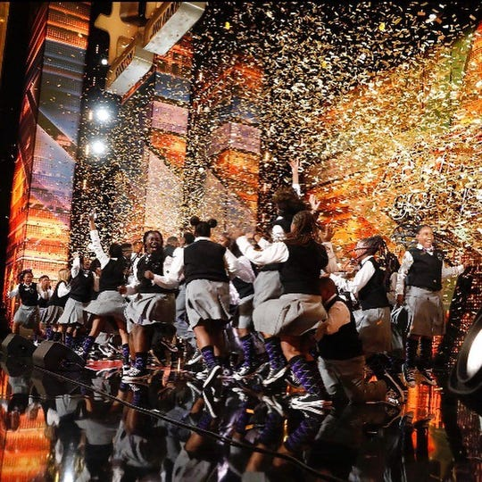 """Confetti falls from the ceiling and the Detroit Youth Choir erupts in cheers after host Terry Crews gave the choir a golden buzzer during its run on """"America's Got Talent."""""""