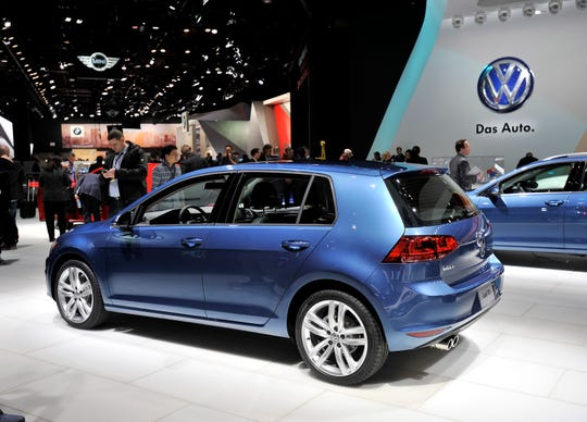 The 2015 Golf TDI, Car of the Year, is displayed on the Volkswagen stage at the North American International Auto Show in Detroit in this Jan. 12, 2015, file photo.