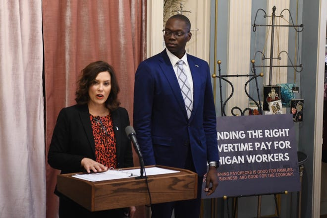 Gov. Gretchen Whitmer along and with Lt. Gov. Garlin Gilchrist announce their plan to expand the right to overtime for more Michigan workers during a news conference at the Fisher Building in Detroit on Thursday.
