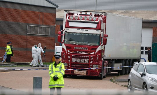Police forensic officers attend the scene after a truck was found to contain a large number of dead bodies, in Thurrock, South England, Wednesday Oct. 23, 2019.
