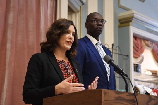 Gov. Gretchen Whitmer and Lt. Gov. Garlin Gilchrist announce their plan to expand the right to overtime for more Michigan workers at a news conference at the Fisher Building in Detroit on Thursday.