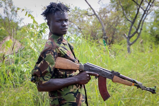 In this photo taken Wednesday, Aug. 28, 2019, an opposition soldier stands guard at an opposition military camp near the town of Nimule in Eastern Equatoria state, South Sudan.